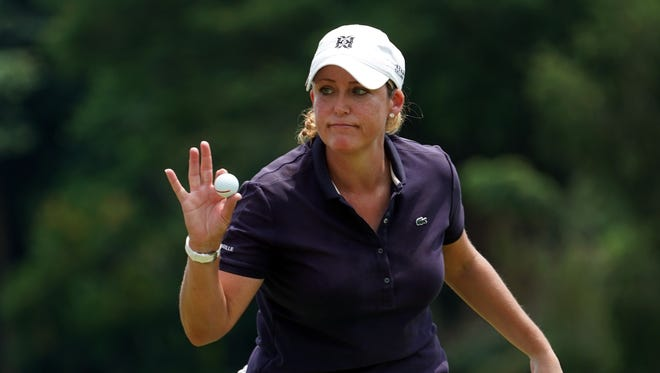 Cristie Kerr of the United States reacts after sinking a birdie during day three of the Sime Darby LPGA Malaysia at TPC Kuala Lumpur East Course on Oct. 28 in Kuala Lumpur, Malaysia.