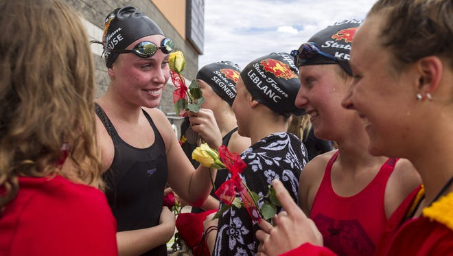 Chaparral swimmers celebrate after winning the Div. II Girls Swimming State Championship on Saturday, Nov. 4, 2017 at Skyline Aquatic Center in Mesa, Ariz.