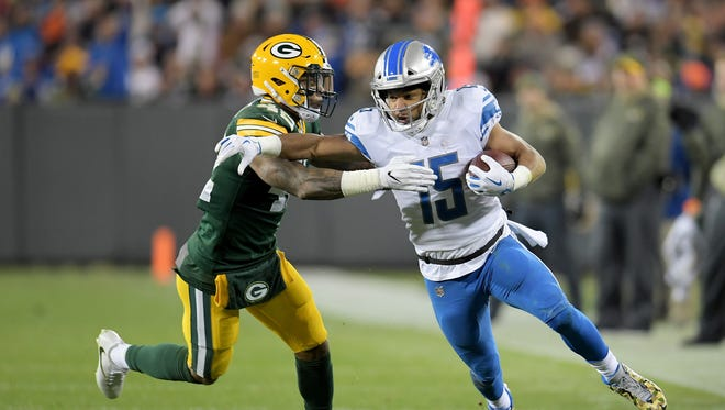Packers' Morgan Burnett tackles the Lions' Golden Tate in the second quarter at Lambeau Field, Monday, Nov. 6, 2017.
