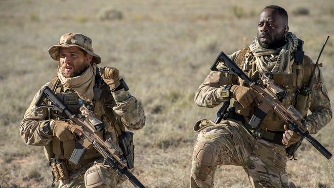 Mike Vogel, left, plays Captain Adam Dalton and  Demetrius Grosse plays CPO Ezekiel 'Preach' Carter in NBC's 'The Brave.'