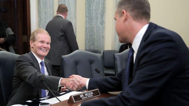 Sen. Bill Nelson, D-Florida, greets then-Rep. Jim Bridenstine, an Oklahoma Republican, prior to a Nov. 1, 2017, confirmation hearing on Bridenstine's nomination to be NASA administrator. Bridenstine was sworn in to lead NASA on April 23, 2018.