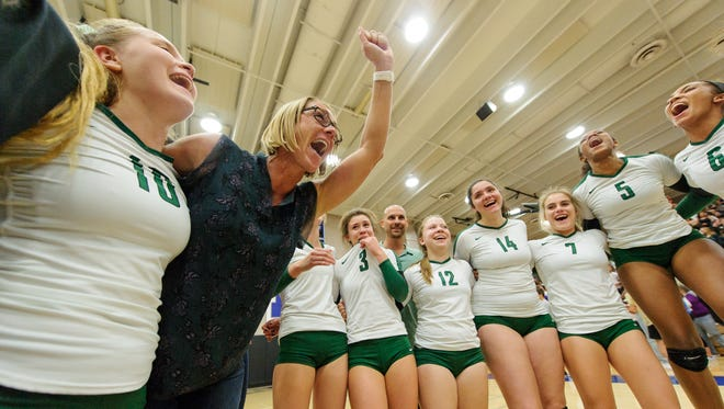 Sunnyslope's head coach Amber LeTarte celebrates with her team after winning the AIA Div 5A Volleyball State championships on Thursday, Nov. 9, 2017, at Mesquite High School in Gilbert, Ariz.