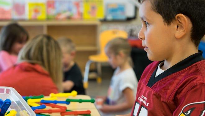 Marco Casillas, 5, plays in Susie Markosian's prekindergarten class at Sue Sossaman Early Childhood Development Center in Queen Creek on Feb. 15, 2017.