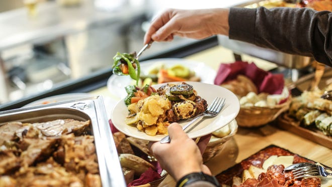 Does everything look good at a party buffet? Try these tips to help you eat in moderation.