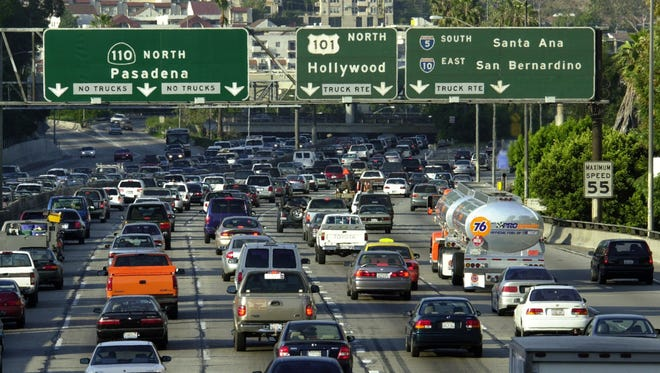 FILE - Traffic fills the 110 freeway during rush hour, May 7, 2001, in downtown Los Angeles, CA.