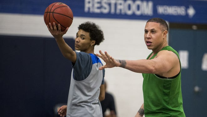 Shadow Mountain's Jaelen House holds the ball while head coach Mike Bibby gives instructions during practice at Shadow Mountain High School on Monday, Nov. 13, 2017 in Phoenix.