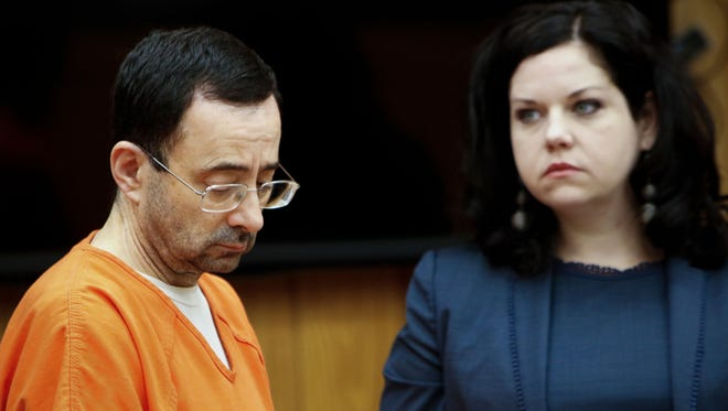 Former gymnastics doctor Larry Nassar appears in Circuit Judge Janice Cunningham's Eaton County courtroom Wednesday, Nov. 29, 2017. Nassar pleaded guilty to three counts of first-degree criminal sexual conduct. Also pictured is Nassar's attorney Shannon Smith.
