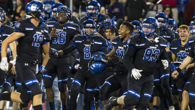 Chandler celebrates after defeating Perry for the 6A State Championship on Saturday, Dec. 2, 2017 at Arizona Stadium in Tucson, Ariz. Chandler won, 49-42.