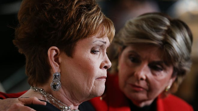 Beverly Young Nelson, left, speaks to the media with her lawyer Gloria Allred, at a news conference where she has accused Alabama Republican Senate candidate Roy Moore of sexually abusing her when she was 16 on November 13, 2017 in New York City.