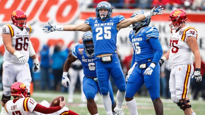 Memphis' Austin Hall (middle) celebrates a sack against Iowa State in last season's AutoZone Liberty Bowl. The Tigers lost 21-20.