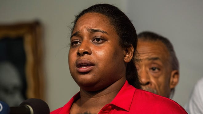 Erica Garner, 27, shown in a file photo, was hospitalized on Christmas Eve following a heart attack. The activist became an critic of police brutality following the death of her father, Eric Garner, in 2014, as he was being arrested on Staten Island on suspicion of selling single cigarettes from packs without tax stamps.