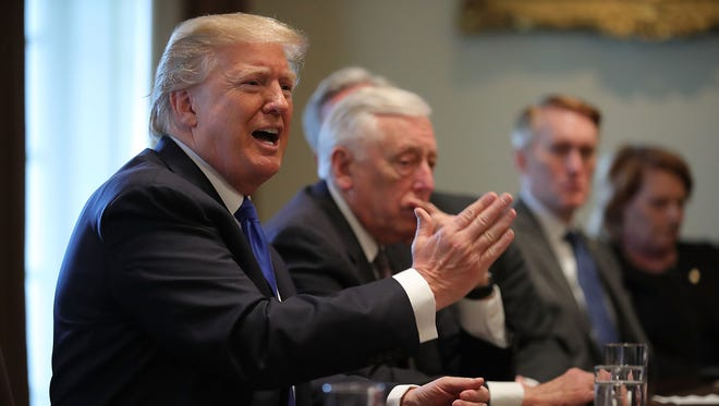 President Trump presides over a meeting about immigration with Republican and Democrat members of Congress in the Cabinet Room at the White House Tuesday.
