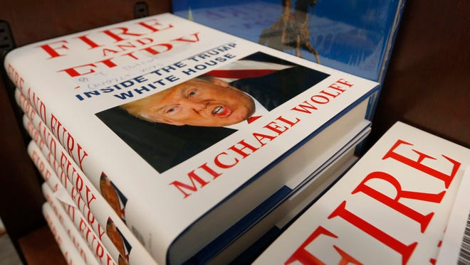 """A stack of """"Fire and Fury"""" books by writer Michael Wolff sit on a shelf in a bookstore in Richmond, Va."""
