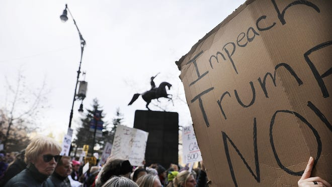 Thousands of men and women hold signs and rally while attending the Women's March on Jan.y 20, 2018 in New York.
