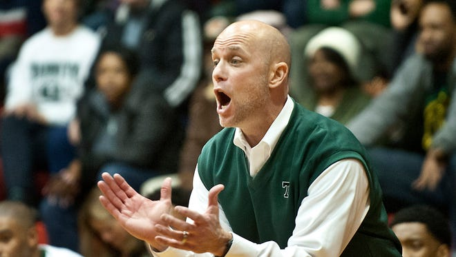 Trinity head basketball coach Mike Szabo yells instructions to his players in the boys Louisville Invitational Tournament championship. Jan. 21, 2018