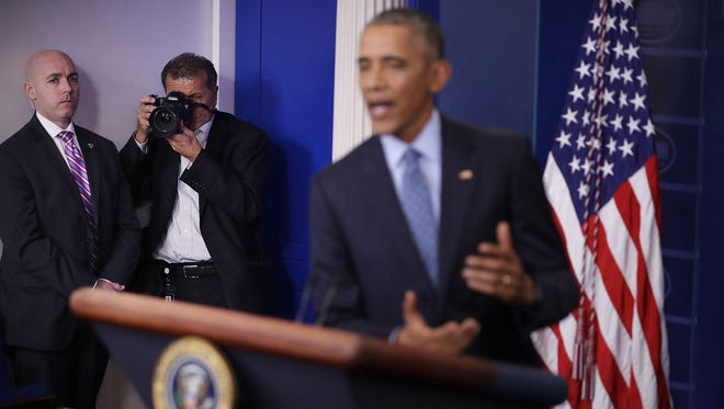 White House Chief Photographer Pete Souza takes images of U.S. President Barack Obama during the last news conference of his presidency in the Brady Press Briefing Room at the White House January 18, 2017 in Washington, DC. This was Obama's final question-and-answer session with reporters before New York real estate mogul and reality television personality Donald Trump is sworn in as the 45th president of the United States on Friday.