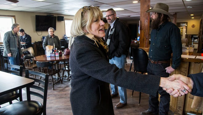 Cathy Glasson, democratic candidate for governor, greets people attending her roundtable discussion about health care and other issues on Tuesday, Jan. 30, 2018, at the Blue Top Tap in Lone Tree.