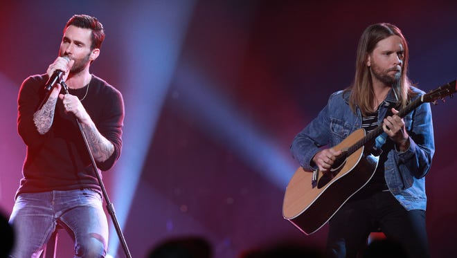 "Adam Levine (left) and James Valentine of Maroon 5 perform during ""One Voice: Somos Live! A Concert For Disaster Relief"" at the Universal Studios Lot on Oct. 14, 2017 in Los Angeles. The band performed at Fiserv Forum in Milwaukee Sunday. Press photographers were not permitted."