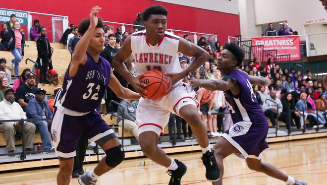 Lawrence North's Tony Perkins drives to the basket against Ben Davis on Friday night.