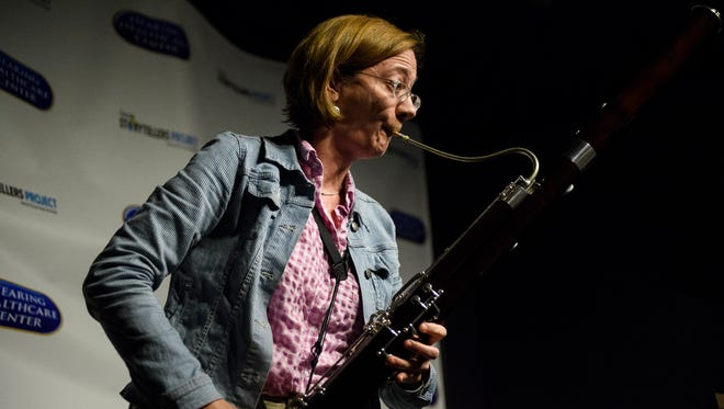 Greenville News journalist Anna Mitchell plays the bassoon during the first Greenville News storytellers series on how love changed her life at Coffee Underground on Tuesday, Feb. 13, 2018.