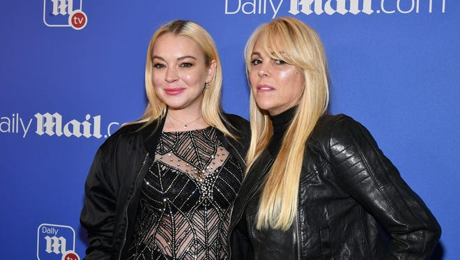 In this Dec. 2017 file photo, Lindsay and Dina Lohan attend a holiday party in New York.