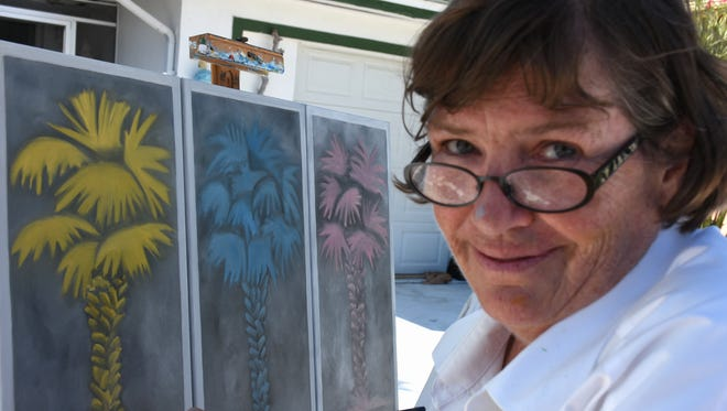 Tara O'Neill with her palm tree variations. The 2018 Marco Island Wet Paint Live event saw artists fan out all over the island and capture it on canvas, with the resulting paintings auctioned off to raise scholarship funds.
