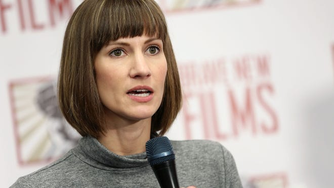 Rachel Crooks speaks during the news conference held by women accusing Trump of sexual harassment in New York City Dec. 11, 2017.