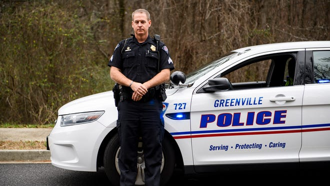 Greenville Police Department officer Sgt. Jason Semanyk poses for a portrait on Wednesday, Feb. 21, 2018 near the ravine where he helped save a formerly homeless man's life. Matt Kern, who led Greenville Police on the chase a year ago, asked officers to shoot him down, but Sgt. Semaynk convinced him to come out willingly into custody.