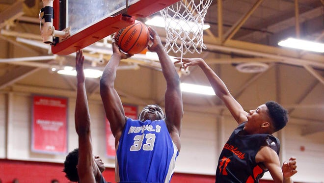 MLK's Matt Smitth (33) puts up a shot between two Stratford defenders during their 10-AA championship game, Tuesday, Feb. 20, 2018, in Nashville, Tenn. (Photo by Wade Payne, Special to the Tennessean)
