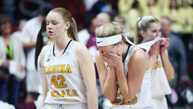 Iowa City Regina's Kennedy Wallace tears up after losing the Class 2A Girls' state basketball quarterfinal game between Iowa City Regina and Grundy Center on Tuesday, Feb. 27, 2018, in Wells Fargo Arena. Grundy Center won the game, 46-45.