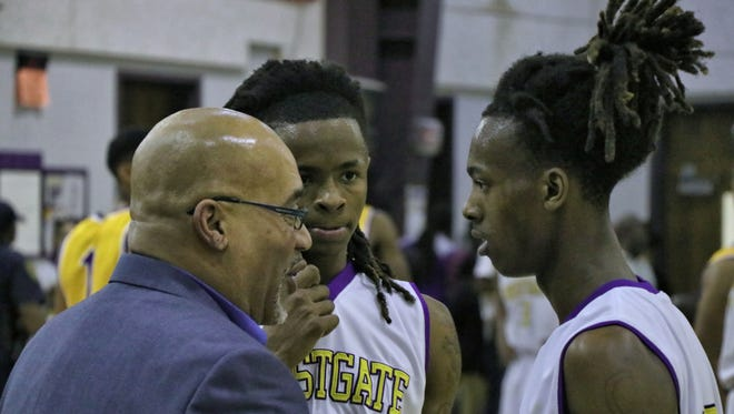 Westgate coach Oliver Winston talks strategy with his talented backcourt of Keyvie Eddie, center, and Tyrun Chevalier, right, during Friday's dramatic 41-39 quarterfinal win over Karr.