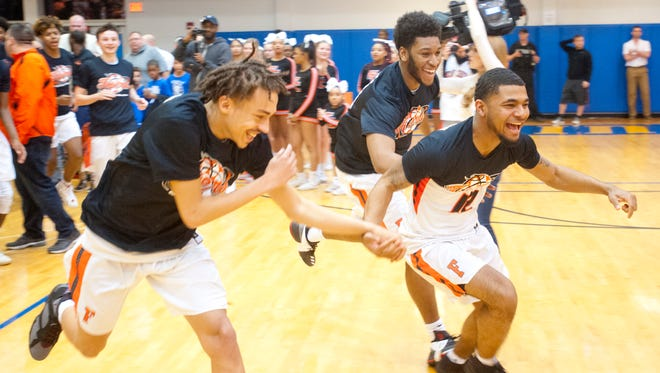 Fern Creek players run out onto the court to collect their Region 6 boys basketball championship trophy after defeating Jeffersontown by just one point.Mar. 06, 2018