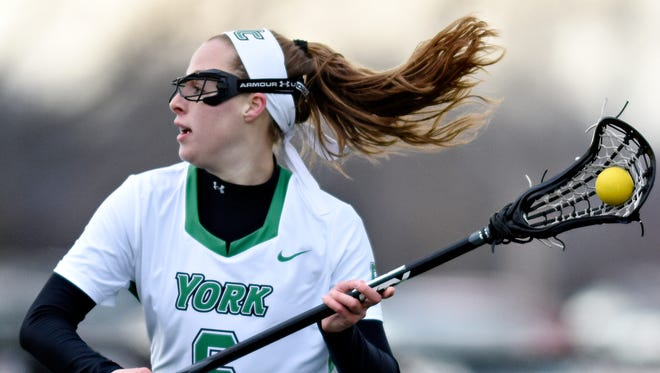 York College's Meghan Fox, seen here in a file photo, scored eight goals Thursday night, helping No. 9 York College defeat No. 3 Trinity (Conn.) College, 16-15, in double overtime during the program's first night game at Kinsley Field. DISPATCH FILE PHOTO