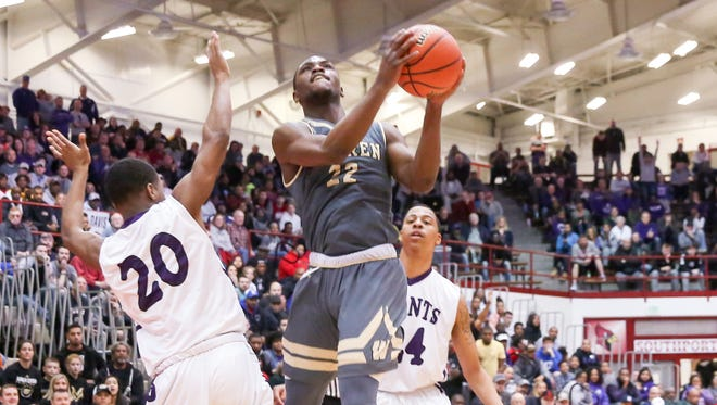 Warren Central's David Bell takes it to the hoop against Ben Davis in Saturday's regional semifinal at Southport.