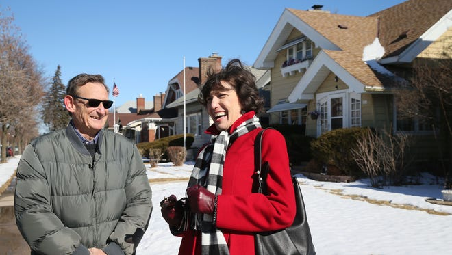 Jon Goldberg-Hiller of Honolulu, left, and Betsy Brenner, former Milwaukee Journal Sentinel publisher,  chat in the area of North 46th and West Wright streets in Milwaukee near the home in which their birth mother lived while growing up. A family in Washington state adopted and reared Brenner.