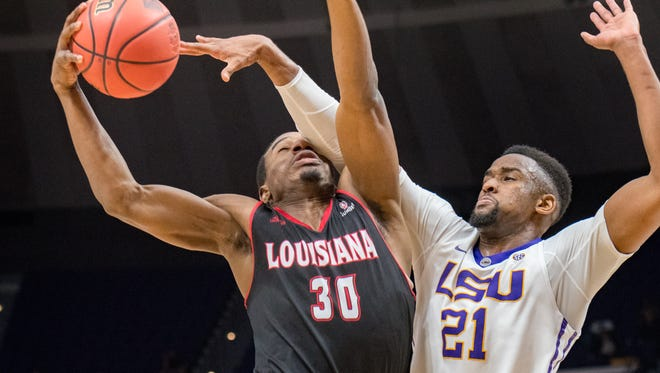 Cajun Johnathan Stove is fouled by Tiger Aaron Epps as the Louisiana Ragin' Cajuns take on the LSU Tigers in the Pete Maravich Assembly Center. Baton Rouge, LA. Wednesday, March 14, 2018.