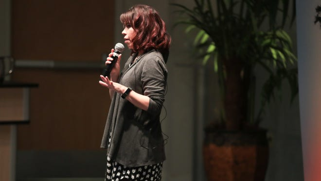 A.E. Santana shares a story at the Coachella Valley Storytellers March event, March 19, 2018.