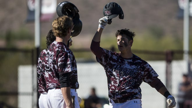 Desert Mountain's Jack Silverman celebrates after hitting a homerun against Basha in the 1st inning on Tuesday, Mar. 20, 2018 in Desert Mountain High School in Scottsdale, Ariz. Desert Mountain won, 6-4.