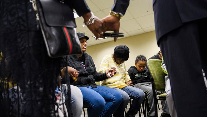 Family and loved ones of Jermaine Massey pray after a press conference addressing the Greenville County Sheriff's Office to address mental illness training on Tuesday, April 3, 2018.