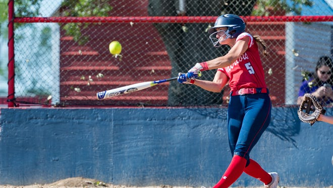 North Vermilion's Kylie Naomi hits one of three Lady Patriot home runs in Monday's run-ruled playoff win over Church Point.