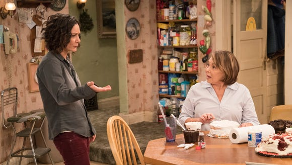 Sara Gilbert as Darlene and Roseanne Barr as Roseanne
