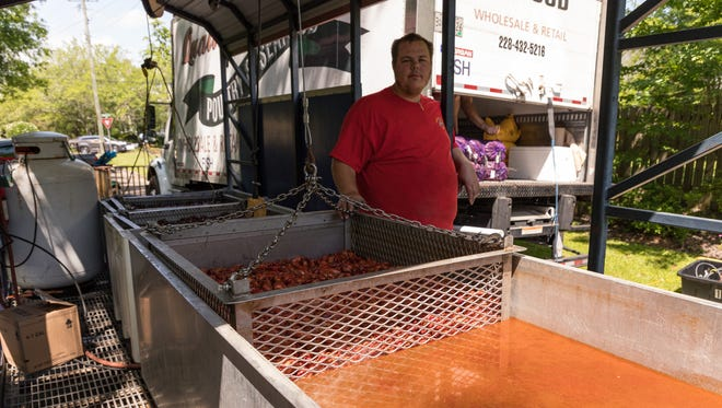 Russell Stirling, with Quality Seafood in Biloxi, cooks up a few hundred pounds of crawfish at a time, plus corn and potatoes during the 20th Annual Downtown Crawfish Jam on Saturday, April 21, 2018 in Hattiesburg.