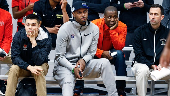 University of Memphis new head basketball coach Penny Hardaway (middle) looks on as he scouts players during Nike EYBL games in Irving, Texas, on April 20, 2018.