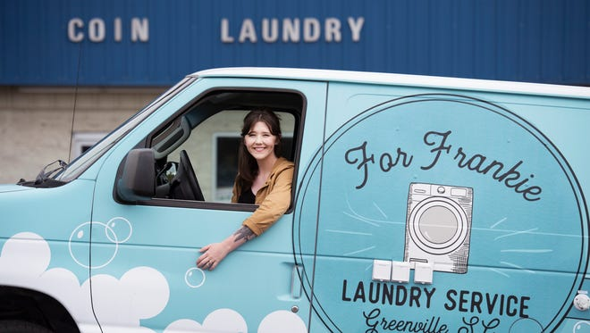 """Adahlia Nix is pictured in a van she was gifted while on the show """"Returning the Favor"""" hosted by Mike Rowe on Monday, April 23, 2018. The van has two sets of washers and dryers in it."""