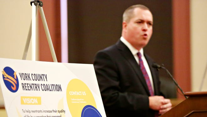 York County chief deputy prosecutor and coalition co-chair Tim Barker speaks during the news conference kickoff for the York County Reentry Coalition at the York County Administrative Center in York City, Tuesday, April 24, 2018. Dawn J. Sagert photo