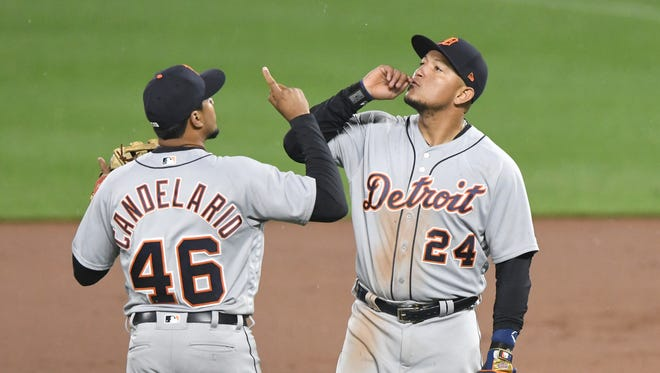 Jeimer Candelario and Miguel Cabrera celebrate the Detroit Tigers' 9-5 win against the Baltimore Orioles at Camden Yards on April 28, 2018 in Baltimore.