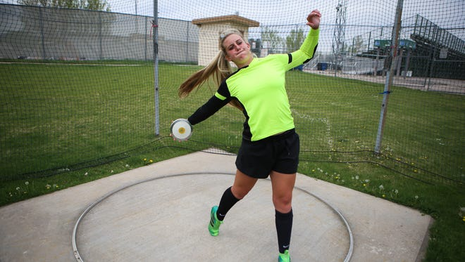 Rocky Mountain's Gabriella McDonald in portrait wearing her goalkeeping jersey and throwing a discus. She's signed to play soccer and compete in the throws on the track and field team at CSU.