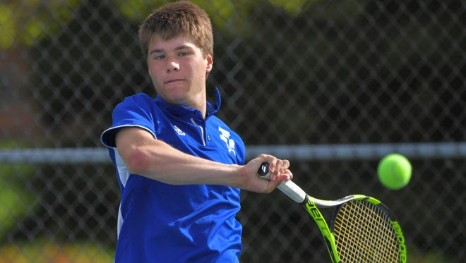 Oshkosh West's Danny Rucinski, who teams with Caleb Schultz at No. 2 doubles, hits a shot against Oshkosh North on May 10.