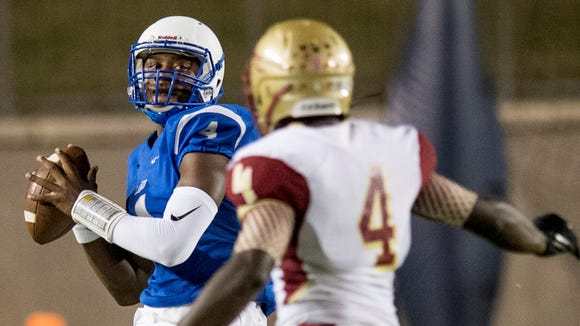 Lanier quarterback James Foster throws against Russell