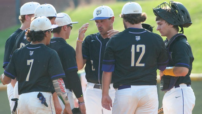 With runners on base, Male head baseball coach Jacob Fiorella tries to calm his starting pitcher Conner Knoop at the mound as the infield comes in for the huddle.May 22, 2018
